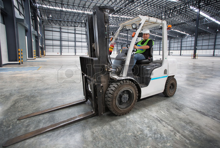 38178478 man driving a forklift through a warehouse in a factory Counterbalance Training